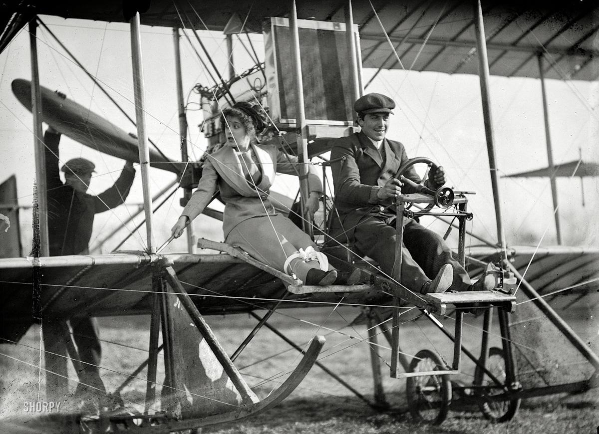 "1911 | Washington , D.C. ""Senorita Lenore Riviera with Antony Jannus in Rex Smith aeroplane"""